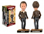 """<h5><a href=""""http://www.royalbobbles.com/bobbleheads/rick-grimes-twd/"""" TARGET=""""_BLANK"""">RICK GRIMES BOBBLEHEAD</a></h5><p>The Rick bobblehead from Royal Bobbles features a lifelike image of The Walking Dead's most iconic character. Each detail, from his signature Colt revolver, to his famed red-handled machete, has been carefully sculpted and painted with the utmost attention to detail that fans are sure to love. </p>"""
