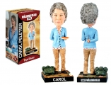 """<h5><a href=""""http://www.royalbobbles.com/bobbleheads/carol-twd/"""" TARGET=""""_BLANK"""">CAROL BOBBLEHEAD</a></h5><p>The Carol bobblehead from Royal Bobbles appears innocent in the front, but her true strength and cunning personality is revealed in the fighting knife concealed behind her back.  It also features a Cherokee Rose in memory of Sophia, and her munitions backpack. </p>"""