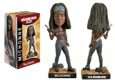 """<h5><a href=""""http://www.royalbobbles.com/bobbleheads/michonne-twd/"""" TARGET=""""_BLANK"""">MICHONNE BOBBLEHEAD</a></h5><p>The Michonne bobblehead from Royal Bobbles is as impressive as her character on the hit television show The Walking Dead. She is featured drawing her katana, ready for action, with the severed heads of her former pets at her feet behind her. From the real metal chain at her feet, to the studs on her leather belt, every detail has been meticulously crafted to truly showcase the essence of her character. </p>"""
